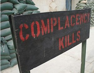 complacency kills sign